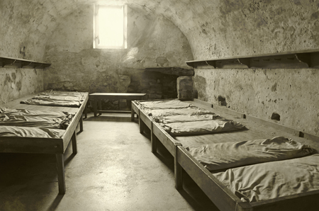 ancient prison: Old prison cell interior view stained duotone