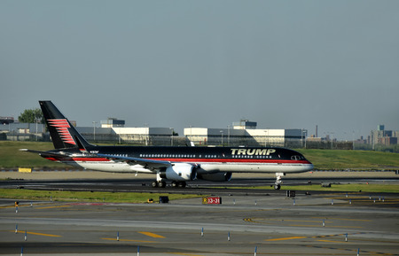 donald: New York, USA - September 17, 2015: Boeing 757 jet airplane bearing the logo of Donald Trump takes off from laguardia, New York City