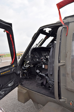 Military helicopter on the ground open cockpit door Фото со стока
