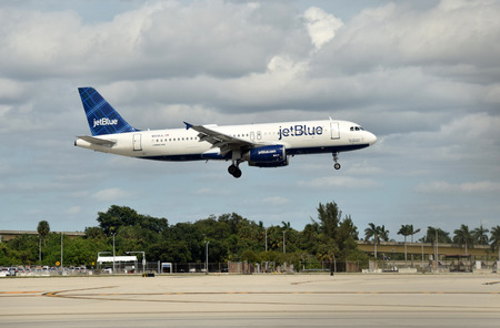 jetblue: Fort Lauderdale, USA - October 17, 2015: Jetblue passenger jet airplane Airbus A-320 arrives in Fort Lauderdale from its home base in New York on Octover 17, 2015