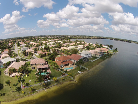 Waterfront suburban homes in Florida aerial view