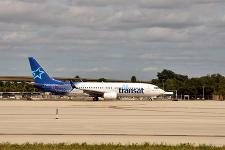 jetliner: Fort Lauderdale, USA - October 17, 2015: Air Transat passenger jet airplane departs from Fort Lauderdale to its home base in canada on Octover 17, 2015 Editorial