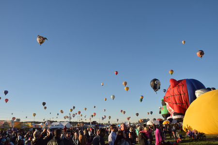 hundreds: ALBUQUERQUE - OCTOBER 7: Hundreds of hot air balloons take flight during the International Balloon Fiesta in Albuquerque NM on October 7, 2016 Editorial