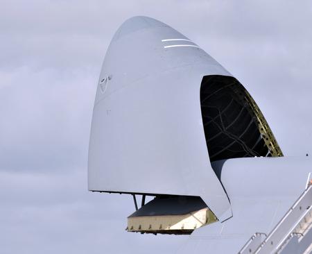 Military cargo jet airplane open nose cargo bay