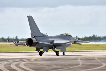 Modern fighter jet airplane taxiing for departure on a mission rear view Stok Fotoğraf