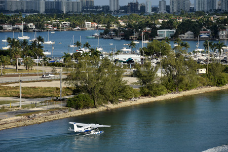 Seaplane departs from the waterways of Miami to the Caribbean Stock Photo