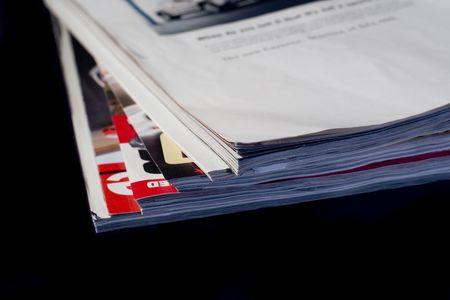 Corner of stack of used magazines isolated on black background Stok Fotoğraf