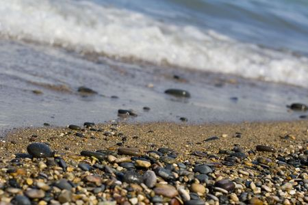 Waves breaking on sand and pebble beach