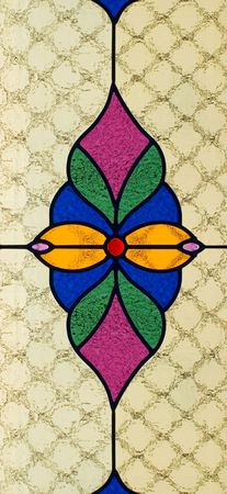 colored window: Stained glass window with multi colored symmetrical pattern and dimpled texture Stock Photo