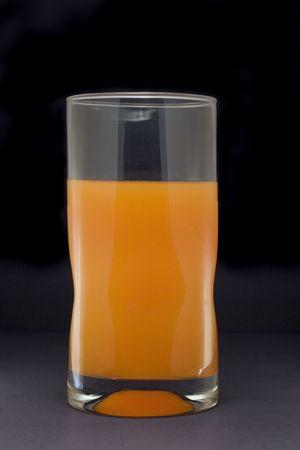 Tall glass holding orange juice isolated on white background Stok Fotoğraf