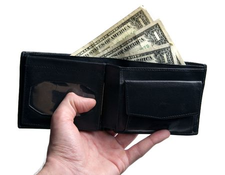 Hand holding black leather wallet with dollar bills sticking out isolated on white background Stok Fotoğraf