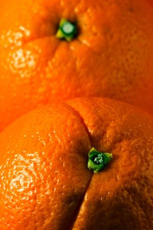 Vertical photo of two whole oranges, each covering half frame Stok Fotoğraf