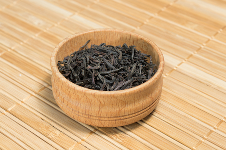 dry leaves: black teablack tea in a wooden bowl. Ukraine Stock Photo