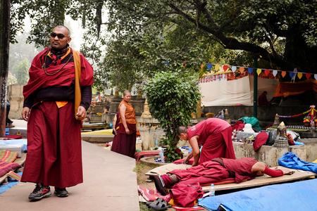 gaya: GAYA, INDIA - DECEMBER 3, 2016: Buddhist monks pray and meditate at Bodh Gaya Stupa, Gaya, India.