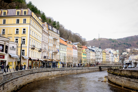 KARLOVY VARY, CZECH REPUBLIC - MARCH 12, 2017: A beautiful view of riverside architecture of Karlovy Vary, the famous spa city in Czech Republic.