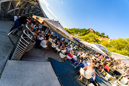 Graz, Styria  Austria - 07 09 2016 : Mur island bridge in Graz full of people enjoying a concert sunny evening Editorial