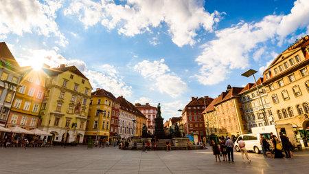 Graz, Styria / Austria - 07 09 2016 : View on Hauptplatz city square and fountain in the city center, summer sun
