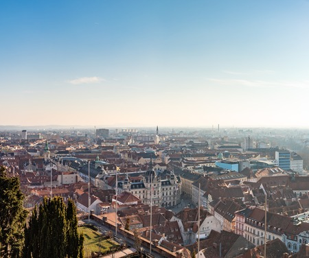 View at City hall from Schlossberg hill, city center, clock tower Sun on the winter blue sky. Travel destination. Stock Photo