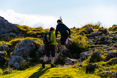 A couple hiking over mountain in Austria Styria.Shockl a tourist and hiking destination.