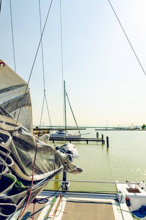 Catamaran boat on the Neusiedlersee lake in Austria. Clear sky calm water before sunset copy space