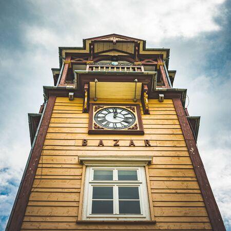 Iwonicz Zdroj, Poland - Old town in Poland Iwonicz Zdroj. View at old wooden clock tower of town hall. Tourist destination Reklamní fotografie