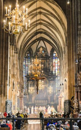 Inside view of Stephansdom St Stephans Cathedral. Church full of tourists during a mass.