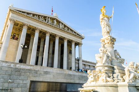 Austrian parliament building with Athena statue on the front Beautiful travel picture with sun light.