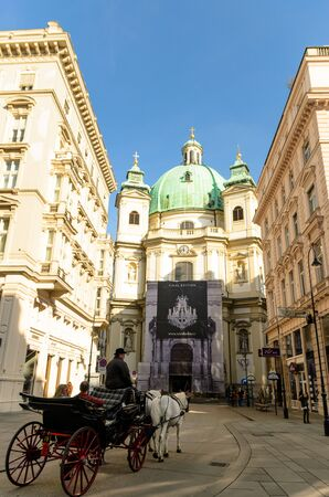 Peterskirche St. Peters Church Horse drawn carriage tour on street of old city. Tourist spot. 報道画像