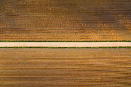 Plowed field in rural area. Landscape of agricultural fields. Aerial view