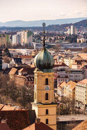 View at Graz city with his famous buildings. River mur. Travel destination vertical photo