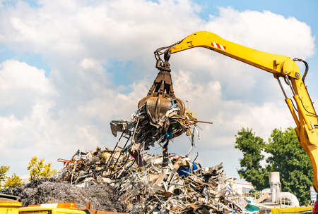 Close-up of a crane for recycling metallic waste on scrapyard