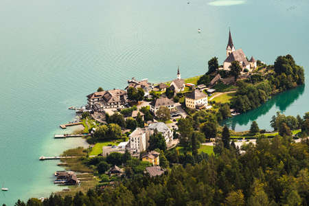 View of the Worthersee lake with Maria Worth church, Carinthia, Austria. Aerial view from pyramidenkogel view tover. Tourist spot
