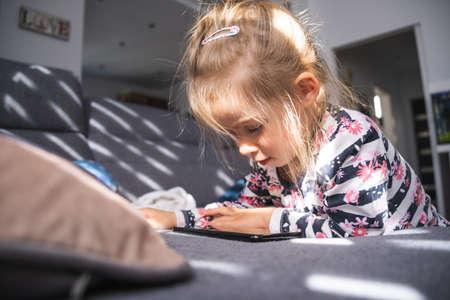 Girl with smartphone on sofa