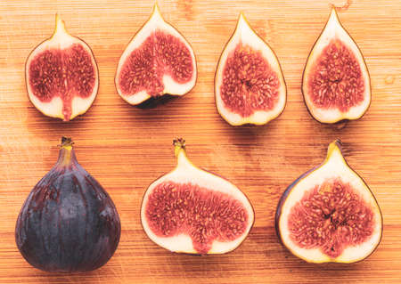Fresh figs isolated on wooden background. Stock Photo