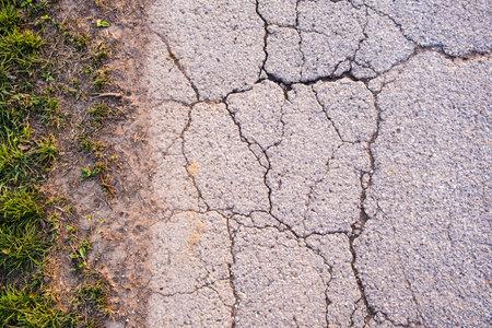 asphalt texture with cracks on rural road Stock Photo
