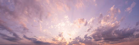 Panorama of sky. Orange blue and violet color sunset sky background.