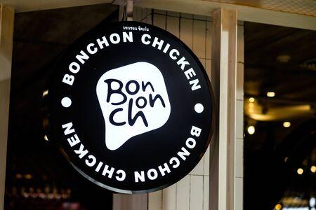 Bangkok, Thailand - December 12, 2019: Close-up glowing Bonchon chicken circular signboard ar MBK center
