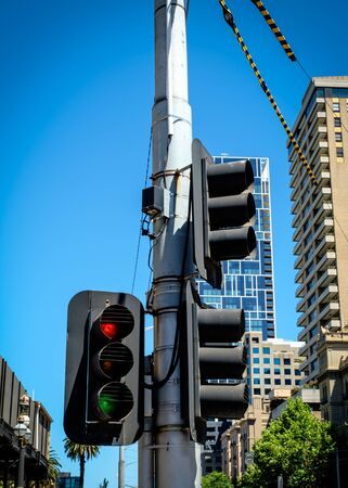 Close-up shot of public traffic lights at the road intersection in the city of Melbourne, Australia