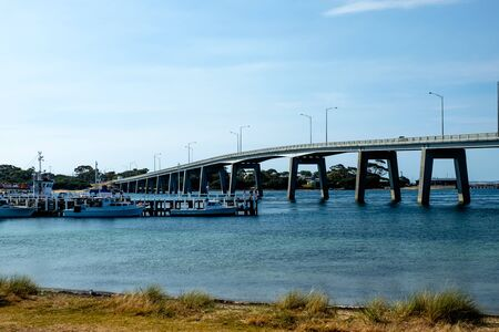 The San Remo bridge connecting between San Remo and Phillip Island with dock yard in Melbourne, Australia Zdjęcie Seryjne