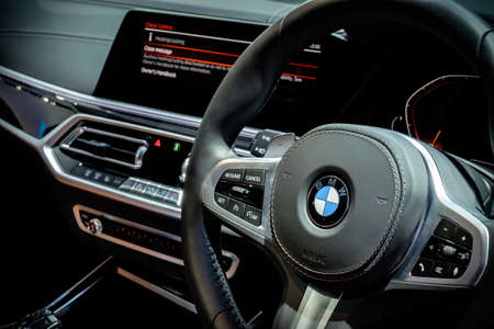 Bangkok, Thailand - December 1, 2019: The interior of BMW 5-series with new steering wheel and infotainment system showcase at the Thailand International Motor Expo 2019 at Impact Challenger Hall