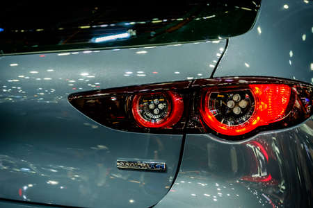 Bangkok, Thailand - December 1, 2019: The tailight of Mazda 3 Fastback Skyactive G  showcase at the Thailand International Motor Expo 2019 at Impact Challenger Hall
