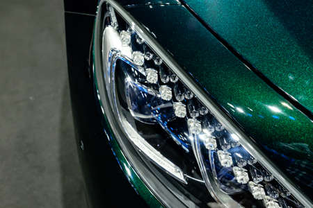 Bangkok, Thailand - December 1, 2019: The Headlight of Mercedes Benz S560 Cabriolet showcase at the Thailand International Motor Expo 2019 at Impact Challenger Hall