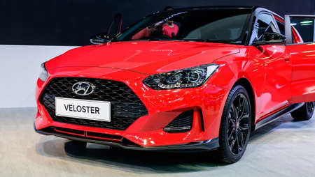 Bangkok, Thailand - December 1, 2019: The red Hyundai Veloster Turbo showcase at the Thailand International Motor Expo 2019 at Impact Challenger Hall Redactioneel