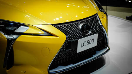 Bangkok, Thailand - December 1, 2019: The iconic front grilled of yellow luxury sport Lexus LC500 showcase at the Thailand International Motor Expo 2019 at Impact Challenger Hall