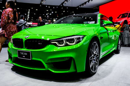 Bangkok, Thailand - December 1, 2019: The green BMW M4 competition showcase at the Thailand International Motor Expo 2019 at Impact Challenger Hall