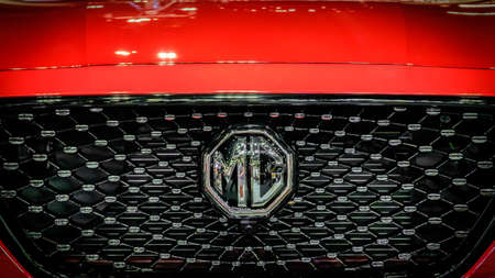 Bangkok, Thailand - December 1, 2019: The front grille of red MG HS showcase at the Thailand International Motor Expo 2019 at Impact Challenger Hall Redactioneel