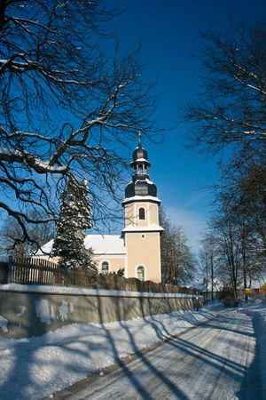 Little chapel in the snow in Landwuest Saxony Germany photo