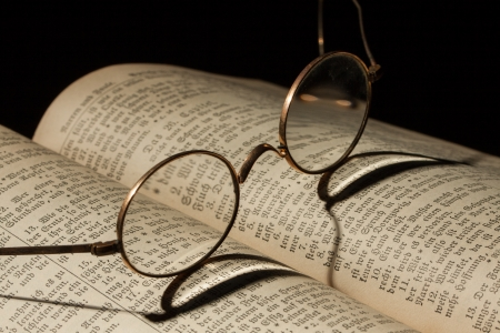 bibliophile: Old Family Bible with eyeglasses