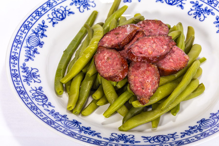 side order: Plate of Green beans with German sausages