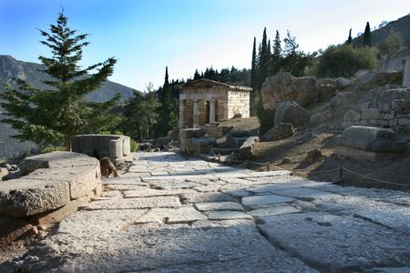 ���archeological site���: Stone-tiled path to the Temple of Apollo in Delphi archeological site, Pelopponese, Greece
